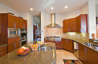 Modern kitchen with fruits on counter in manor house