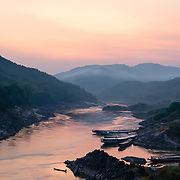 Sunset over Mekhong river and mountains at Pak Beng, Laos