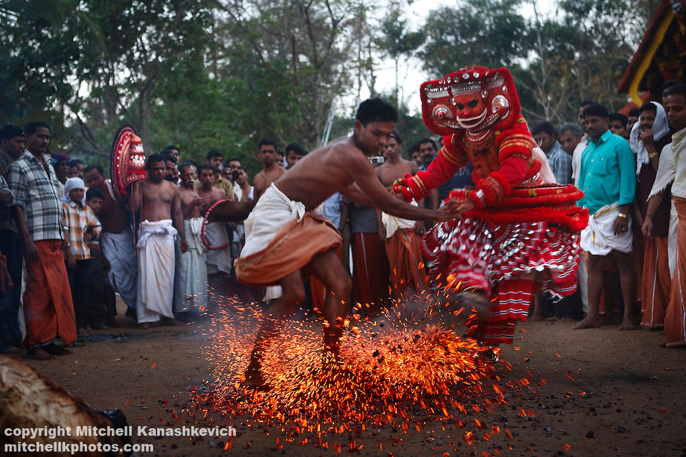 Theyyam performance, Kannur District, Kerala, India. .It is believed that while performing; the artist is possessed by a divine spirit and becomes a God - or Theyyam in the local language. In Hinduism there are literally millions of Gods; both good and evil and The four hundred existing variations of Theyyam performances are dedicated to just some of them.