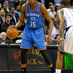 January 24,  2011; New Orleans, LA, USA; Oklahoma City Thunder small forward Kevin Durant (35) is defended by New Orleans Hornets small forward Trevor Ariza (1) during the second half at the New Orleans Arena. The Hornets defeated the Thunder 91-89. Mandatory Credit: Derick E. Hingle