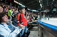 KELOWNA, CANADA - FEBRUARY 28: A young fan looks on as the Calgary Hitmen play the Kelowna Rockets on February 28, 2015 at Prospera Place in Kelowna, British Columbia, Canada.  (Photo by Marissa Baecker/Shoot the Breeze)  *** Local Caption *** fans;