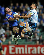 23/04/2011 SPORT: Super Rugby - Western Force vs Bulls at nib Stadium, Perth. PICTURED - Force's Richard Brown and Bull Pierre Spies both attempt to mark the ball.