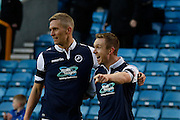 Millwall FC Midfielder Shane Ferguson is joined by Millwall FC Forward Steve Morison (C) during the Sky Bet League 1 match between Millwall and Colchester United at The Den, London, England on 21 November 2015. Photo by Andy Walter.