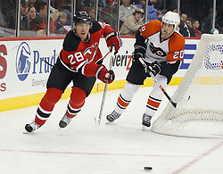 November 8, 2007; Newark, NJ, USA;   New Jersey Devils defenseman Karel Rachunek (28) and Philadelphia Flyers center R.J. Umberger (20) turn up ice during the third period at the Prudential Center in Newark, NJ.  The Devils won the game by a 4-1 score.