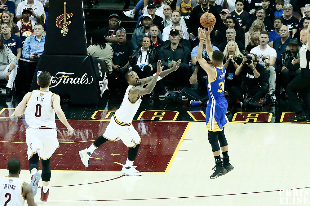 09 June 2017: Golden State Warriors guard Stephen Curry (30) takes a jump shot over Cleveland Cavaliers guard JR Smith (5) during the Cleveland Cavaliers 137-11 victory over the Golden State Warriors, in game 4 of the 2017 NBA Finals, at  the Quicken Loans Arena, Cleveland, Ohio, USA.