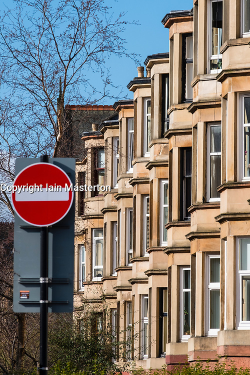 View of row of traditional sandstone tenement apartment buildings in Glasgow West End. No entry sign to indicate too expensive to buy for first time buyers, Glasgow, Scotland, United Kingdom