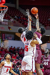 NORMAL, IL - November 10: Abdou Ndiaye attempts a block on a shot by Kamani Johnson during a college basketball game between the ISU Redbirds and the Little Rock Trojans on November 10 2019 at Redbird Arena in Normal, IL. (Photo by Alan Look)