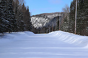 I love the look of fresh powder snow. This seasonal back country road follows a parallel path to the Keweenaw's Cliff Range. About 2.5 miles into the forest (just beyond the curve ahead), the snow plowing stops.