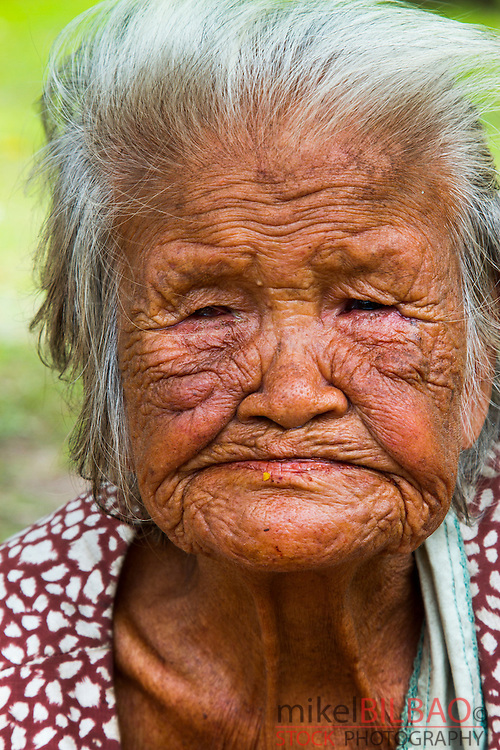 Old woman portrait. Sukhothai Historical Park. Thailand.