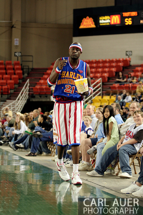 "04 May 2006: Stolen popcorn in hand, Kevin ""Special K"" Daley heads off to look for his next prank victim during the Harlem Globetrotters vs the New York Nationals at the Sulivan Arena in Anchorage Alaska during their 80th Anniversary World Tour.  This is the first time in 10 years that the Trotters have visited Alaska."