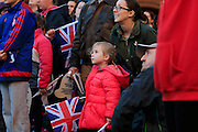 Spectators watch the big screens in Albert Square during the Manchester Olympic Parade in Manchester, United Kingdom on 17 October 2016. Photo by Richard Holmes.