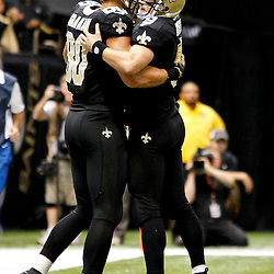 November 5, 2012; New Orleans, LA, USA; New Orleans Saints quarterback Drew Brees (9) celebrates with tight end Jimmy Graham (80) after a touchdown during the second half of a game against the Philadelphia Eagles at the Mercedes-Benz Superdome. The Saints defeated the Easgles 28-13. Mandatory Credit: Derick E. Hingle-US PRESSWIRE