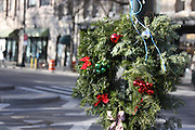 A lamp post in Manhattan's Upper West Side neighborhood is adorned with a holiday wreath in early December.