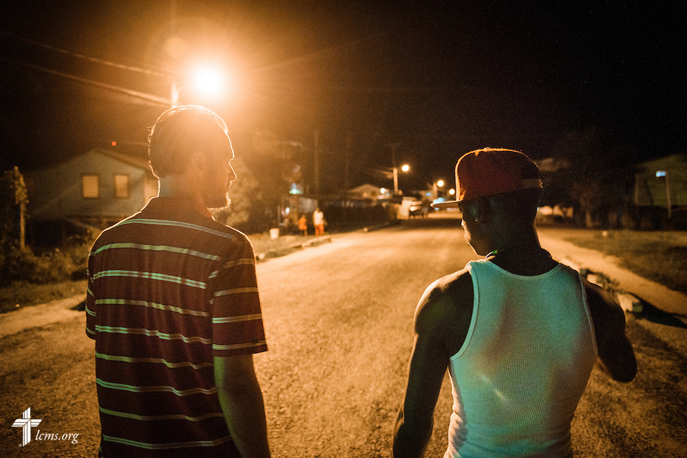 The Rev. Duane Meissner, career missionary to Belize, walks with Cedric, a local friend and guide, on Wednesday evening, Sept. 28, 2016, in Seine Bight, Belize. LCMS Communications/Erik M. Lunsford