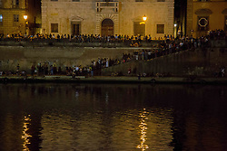 June 17, 2017 - Italy - Traditional San Ranieri Regatta in Pisa. The famous Luminaria is dedicated to San Ranieri since 1688, when the grand duke of Tuscany, Cosimo de' Medici, decided to put his body into a precious, marble tomb. At sunset, every June 16, thousands of candles previously put onto Pisa's bridges, near doors and windows are lit up. (Credit Image: © Lorenzo Apra/Pacific Press via ZUMA Wire)