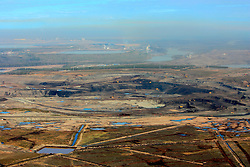 CANADA ALBERTA FORT MCMURRAY 10MAY07 - Aerial view of Suncor mine and upgrader plant in the background north of Fort McMurray, Alberta, Canada. The Alberta Tar Sands are the largest deposits of their kind in the world and their production is the single largest contributor to Canada's greenhouse gas emissions...Alberta's tar sands are currently estimated to contain a crude bitumen resource of 315 billion barrels, with remaining established reserves of almost 174 billion barrels, thus making Canada's oil resources ranked second largest in the world in terms of size...The industry has brought wealth and an economic boom to the region but also created an environmental disaster downstream from the Athabasca river, polluting the lakes where water and fish are contaminated. The native Indian tribes of the Mikisew, Cree, Dene and other smaller First Nations are seeing their natural habitat destroyed and are largely powerless to stop or slow down the rapid expansion of the oil sands development, Canada's number one economic driver...jre/Photo by Jiri Rezac / WWF-UK..© Jiri Rezac 2007..Contact: +44 (0) 7050 110 417.Mobile: +44 (0) 7801 337 683.Office: +44 (0) 20 8968 9635..Email: jiri@jirirezac.com.Web: www.jirirezac.com..© All images Jiri Rezac 2007 - All rights reserved.