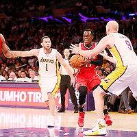 03 November 2013: Atlanta Hawks point guard Dennis Schroder (17) drives past Los Angeles Lakers point guard Jordan Farmar (1) and Los Angeles Lakers center Chris Kaman (9) during the Los Angeles Lakers 105-103 victory over the Atlanta Hawks at the Staples Center, Los Angeles, California, USA.