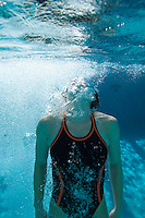 Young female swimmer in swimming pool