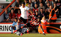 Max Gradel of Bournemouth goes down under the challenge of Enzo Perez of Valencia - Mandatory by-line: Robbie Stephenson/JMP - 03/08/2016 - FOOTBALL - Vitality Stadium - Bournemouth, England - AFC Bournemouth v Valencia - Pre-season friendly