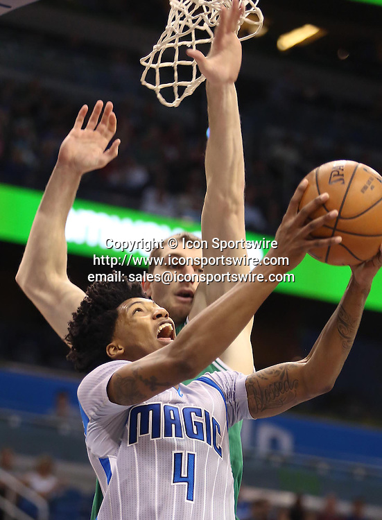 Dec. 23, 2014 - Orlando, FL, USA - The Orlando Magic's Elfrid Payton (4) scores against the Boston Celtics at the Amway Center in Orlando, Fla., on Tuesday, Dec. 23, 2014