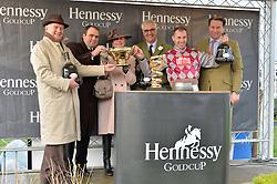 Left to right, PETER ANDREWS owner of the 2015 Hennessy Gold Cup winner Smad Place, trainer ALAN KING, TRISH ANDREWS, MAURICE HENNESSY, jockey WAYNE HUTCHINSON and JO THORNTON at the 2015 Hennessy Gold Cup held at Newbury Racecourse, Berkshire on 28th November 2015.