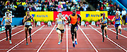 Great Britain's Libby Clegg (C) competes in the women's 100M T12/T44 final, during the Samsung Diamond League meeting at Crystal Palace in London on August 14, 2010.