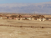 Israel, Dead Sea. Abandoned barracks buildings on the shore