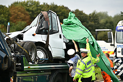 © Licensed to London News Pictures. 26/08/2017. Milton Keynes, UK. REMAINS OF MINI BUS PICTURED. The sceneon the M1 motorway near Newport Pagnell after a crash involving a minibus and two lorries. Police say that several people are dead and four others have been taken to hospital after the accident on the southbound carriageway in the early hours of this morning. Photo credit: Ben Cawthra/LNP