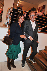 DAVID COLLINS and SOLANGE AZAGURY-PARTRIDGE at an exhibition at The Conran Shop entitled Red to celebrate 25 years of The Conran Shop at the Michelin Building, 81 Fulham Road, London on 19th September 2012.