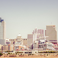 Cincinnati skyline retro panorama picture. Panorama photo ratio is 1:3 and has a vintage retro tone. Includes most popular downtown city buildings including Great American Ballpark, Great American Insurance Group Tower, PNC Tower building, Omnicare building, US Bank building, Carew Tower building, and Scripps Center building.