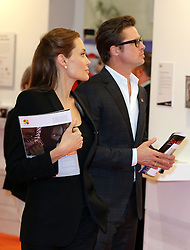 Image licensed to i-Images Picture Agency. 12/06/2014. Angelina Jolie and Brad Pitt  tour an art exhibition  on day three of the End Sexual Violence in Conflict  Global Summit in London.  Picture by Stephen Lock / i-Images