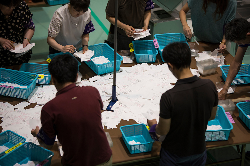 TOKYO, JAPAN - JULY 10 : Election staff members count votes in Parliament's upper house elections at a ballot counting center in Shinjuku Cosmic Sports Center in Shinjuku-ku on July 10, 2016 in Tokyo, Japan. (Photo by Richard Atrero de Guzman/NUR Photo)