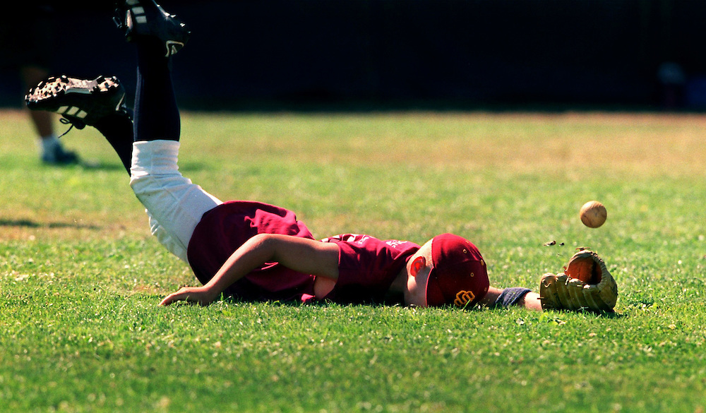 Sean Robinson 12, from Sacramento dives head first/nose first into the truf missing the ball by inches at Sacramento City Collage baseball field. It was the 4th day of the week long baseball camp for youth there.  Next week another camp will start up. PIcture taken Thursday, July 22, 1999.