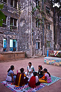 Young girls having a group counselling session at the Kamatipura Centre in Mumbai. The centre welcomes about 100 children every day from the surrounding red-light district. The centre is run by the Prerana organisation who specialise in children of the red-light districts in Mumbai.