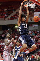 16 November 2014: Daishon Knight watches a slam dunk by Jalen Moore during an NCAA non-conference game between the Utah State Aggies and the Illinois State Redbirds.  The Aggies win the competition 60-55 at Redbird Arena in Normal Illinois.