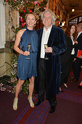 SIR FRANK LOWE and his wife MARTINA at The Backstage Gala hosted by Diana Vishneva , Principal Dancer of the Mariinsky and American Ballet Theatre, and Natalia Vodianova in aid of The Naked Heart Foundation held at The London Coliseum, St.Martin's Lane, London on 17th April 2015.