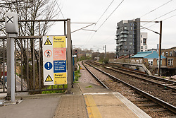 © Licensed to London News Pictures. 21/03/2019. London, UK.  A warning sign of high voltage next to the track at Hackney Wick overground station. Two people were found dead on the Overground Railway track between Stratford and Hackney Wick last night.  Photo credit: Vickie Flores/LNP