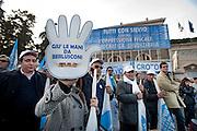 2013/03/23 Roma, manifestazione del PDL Popolo della Liberta'. Nella foto alcuni manifestanti.<br /> Rome, Popolo della Liberta' (reading The Peolple of Freedom Party) demo. In the picture some supporters hold a note reading ' Hands off by Berlusconi ' - &copy; PIERPAOLO SCAVUZZO