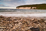 Limestone bluffs and Lake Michigan waves at Fayette State Historical Park near Garden Michigan.