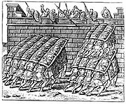 Roman soldiers forming a Tortoise with their shields and approaching the walls of a besieged fortress. Engraving from Justus Lipsius 'Poliorceticon' Antwerp 1605.