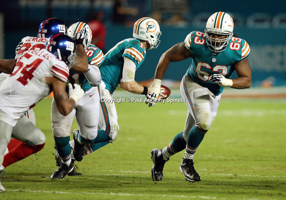 Miami Dolphins offensive guard Dallas Thomas III (63) lead blocks during the NFL week 14 regular season football game against the New York Giants on Monday, Dec. 14, 2015 in Miami Gardens, Fla. The Giants won the game 31-24. (©Paul Anthony Spinelli)