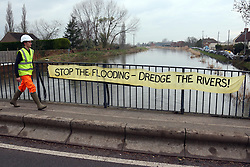 © London News Pictures. 31/01/2014. Burrowbridge, UK. A sign put up by locals in the village of Burrowbridge in Somerset on the Somerset levels.  The area has been hit severely by recent flooding which is forecast to get worse over the weekend . Photo credit: Jason Bryant/LNP