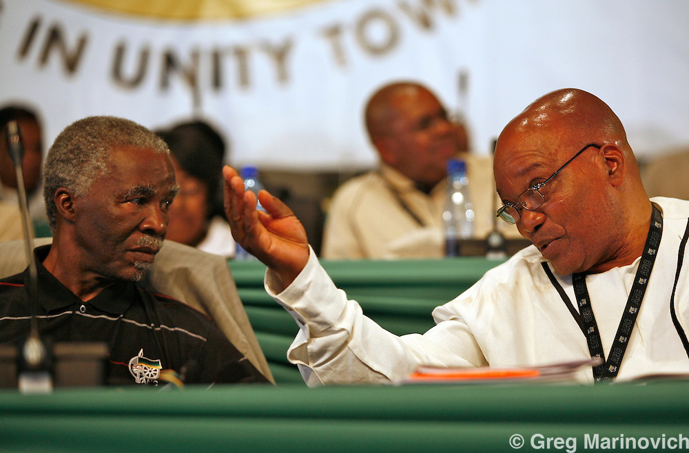 POLOKWANE, SOUTH AFRICA DEC 16, 2007:President Thabo Mbeki (left) and Deputy President Jacob Zuma  at the conference to choose a new National Executive Committee - and the two presidential candidates - President Thabo Mbeki and Deputy President Jacob Zuma -   of the ruling African National Congress (ANC) campaign in Polokwane, Limpopo province, South Africa. Photo Greg Marinovich / Bloomberg News