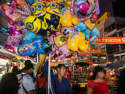 "07 FEBRUARY 2016 - BANGKOK, THAILAND: Selling Chinese New Year toys on Yaowart Road in Bangkok's Chinatown.  Chinese New Year, also called Lunar New Year or Tet (in Vietnamese communities) starts Monday February 8. The coming year will be the ""Year of the Monkey."" Thailand has the largest overseas Chinese population in the world; about 14 percent of Thais are of Chinese ancestry and some Chinese holidays, especially Chinese New Year, are widely celebrated in Thailand.        PHOTO BY JACK KURTZ"