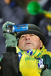 15.06.2010, Ellis Park, Johannesburg, RSA, FIFA WM 2010, Brasilien vs Nordkorea im Bild ein Fan mit einem Brasilien Schal filmt das Spiel mit seiner Kamera, EXPA Pictures © 2010, PhotoCredit: EXPA/ IPS/ Mark Atkins / SPORTIDA PHOTO AGENCY