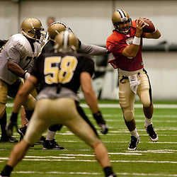 08 August 2009: Quarterback Joey Harrington (3) scrambles from the pocket during the New Orleans Saints annual training camp Black and Gold scrimmage held at the team's indoor practice facility in Metairie, Louisiana.