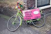 Colourful bicycle used to advertise, Texel, Netherlands,