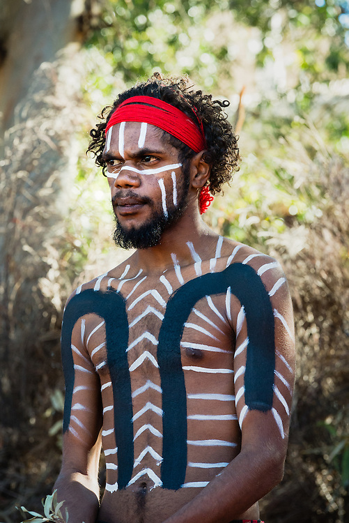 Aboriginal Anangu man wearing traditional body paint to perform inma