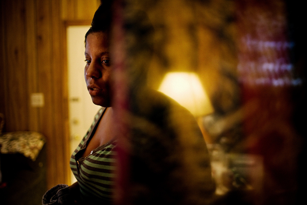 """Lettorea """"Lottie"""" Clark, 25, in the apartment she shares with her daughter Gabby, 2, in Albany, GA on Wednesday, October 22, 2008. Lottie and Gabby live off welfare after escaping an abusive relationship with Gabby's father."""