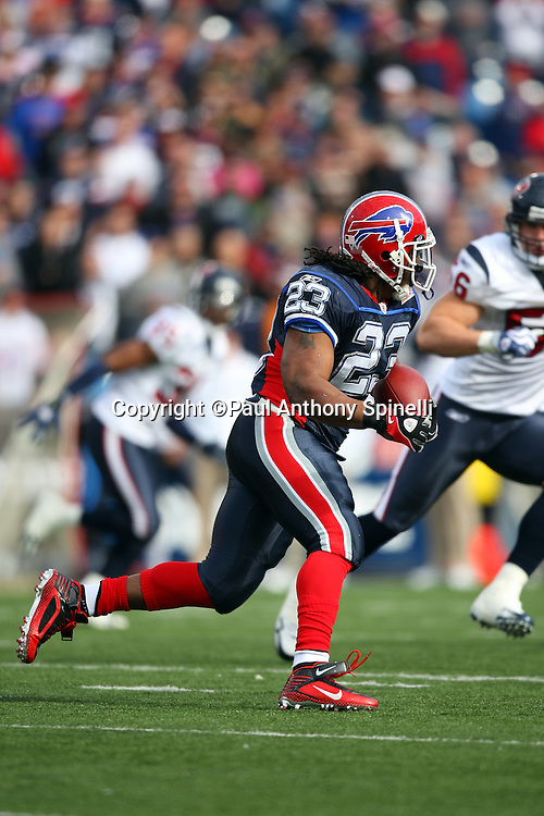 Buffalo Bills running back Marshawn Lynch (23) jumps runs the ball during the NFL football game against the Houston Texans, November 1, 2009 in Orchard Park, New York. The Texans won the game 31-10. (©Paul Anthony Spinelli)